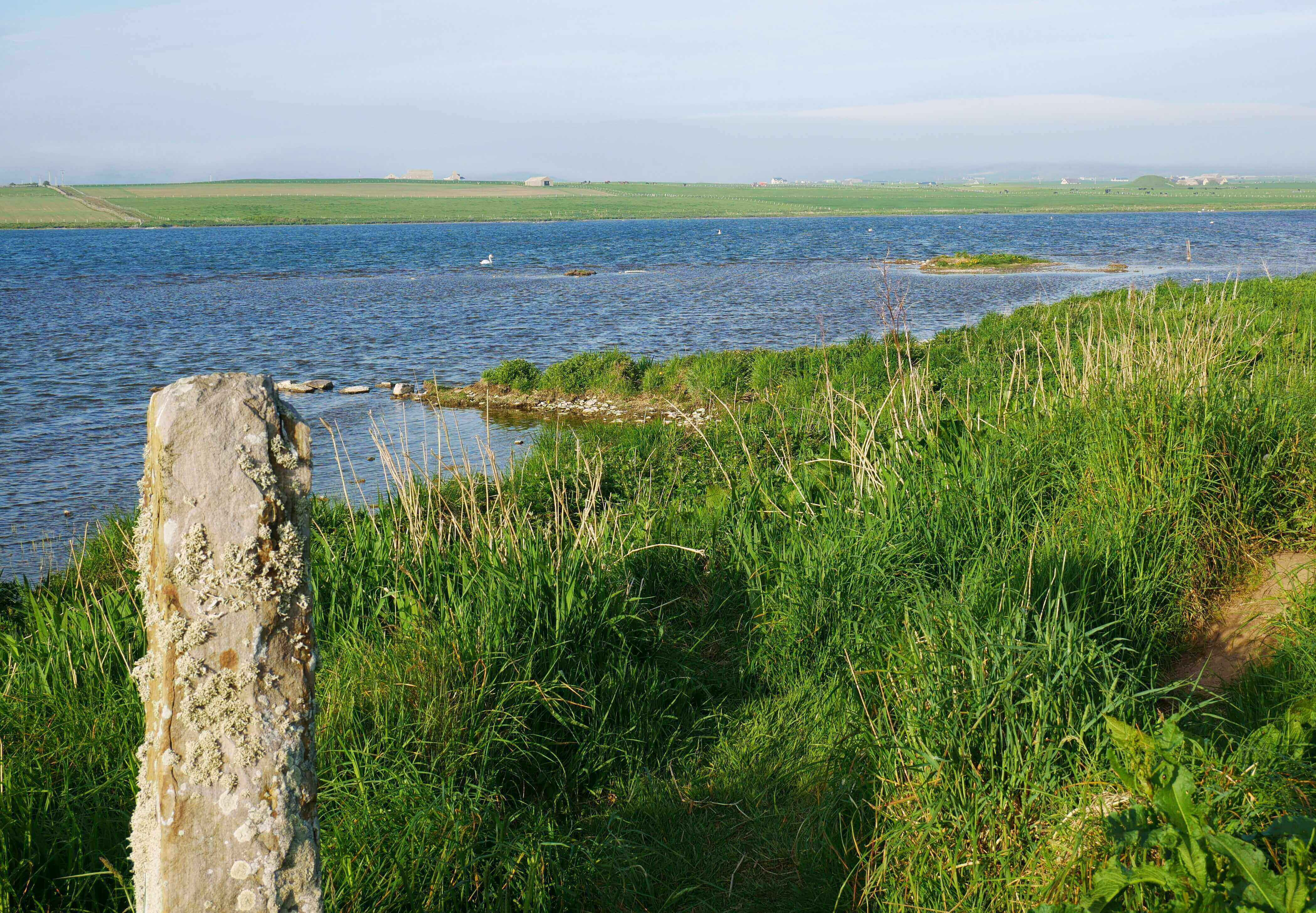 Distant view of Maeshowe from Barnhouse Neolithic Settlement, Orkney Islands, Scotland, UK.  www.orkneyology.com