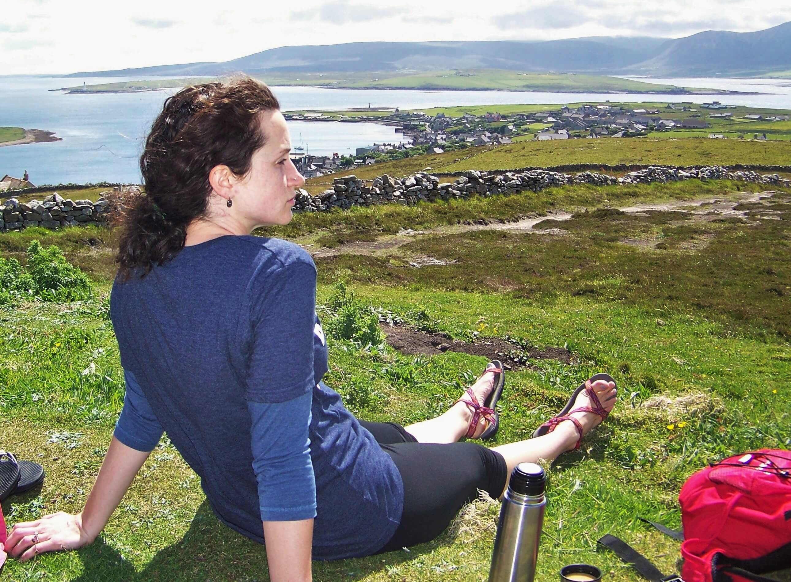Woman takes in view from the brae above Stromness