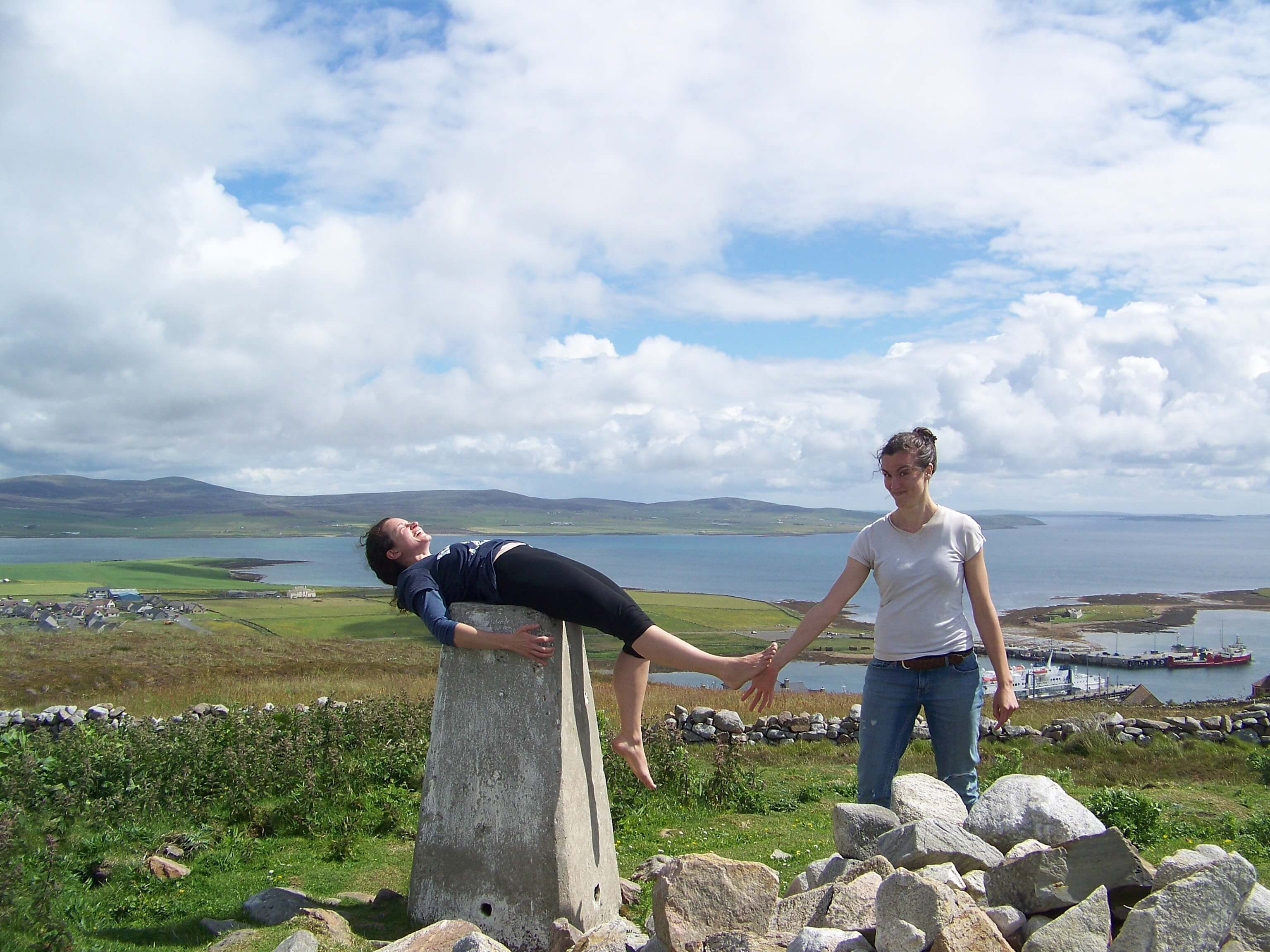 Horseplay at trig point on the brae above Stromness