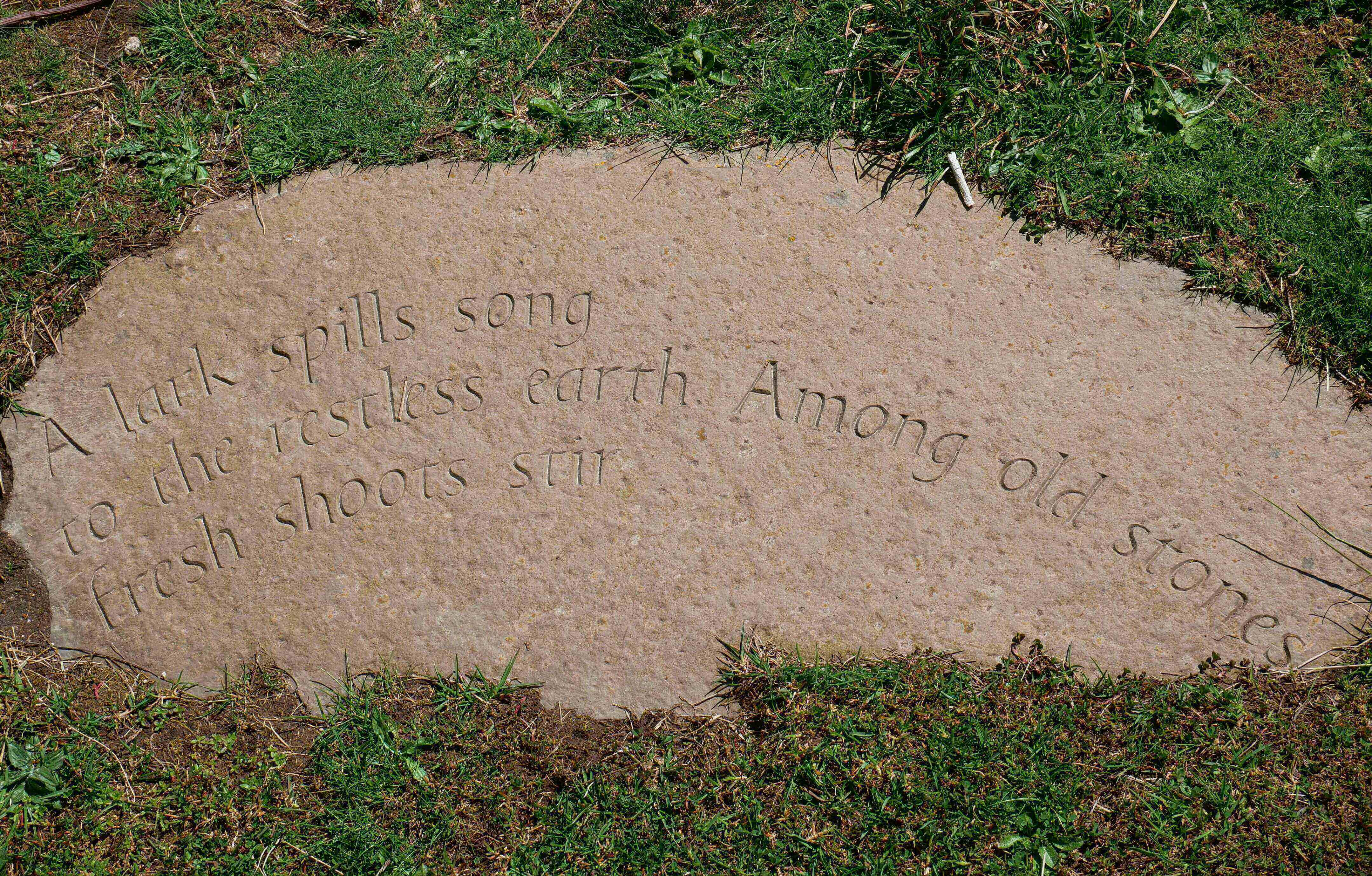 Haiku by Orkney poet Yvonne Gray carved in stone on the brae above Stromness