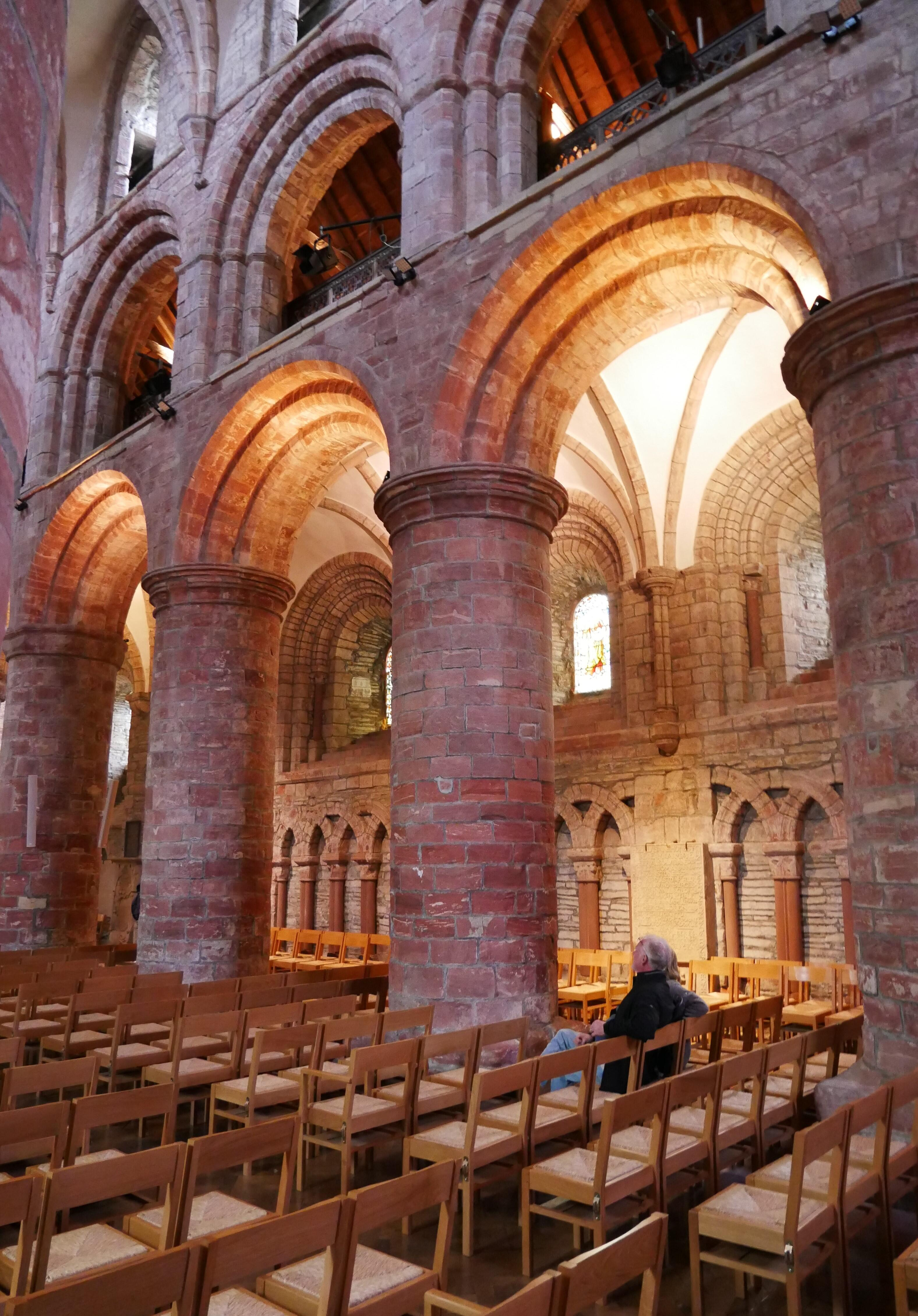 A man sitting alone in St Magnus Cathedral, Kirkwall, Orkney, Scotland, UK