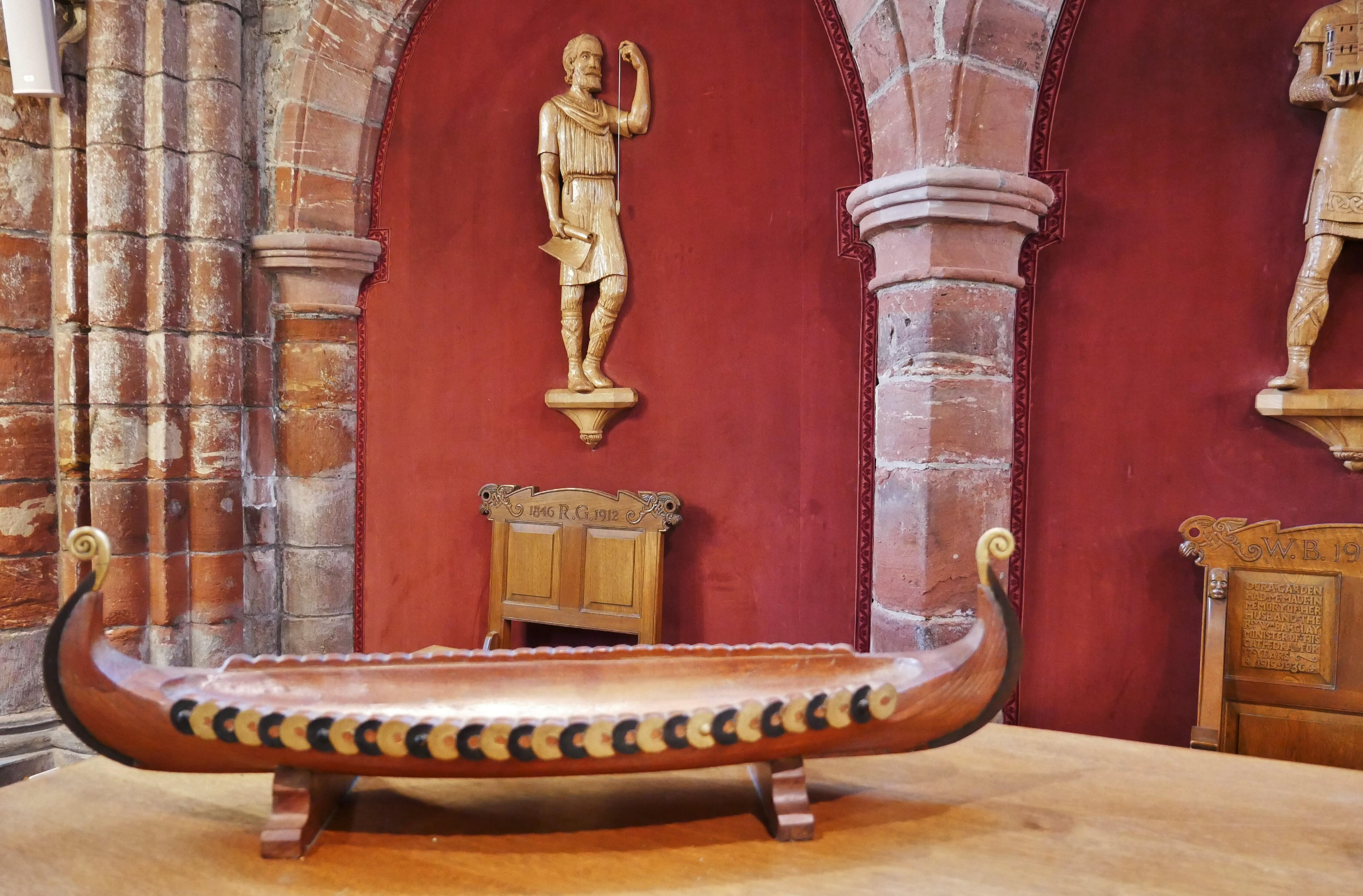 Carved representation of Kol Kalisson, St Rognavald's father who oversaw the early building of the cathedral, Kirkwall, Orkney, Scotland, UK