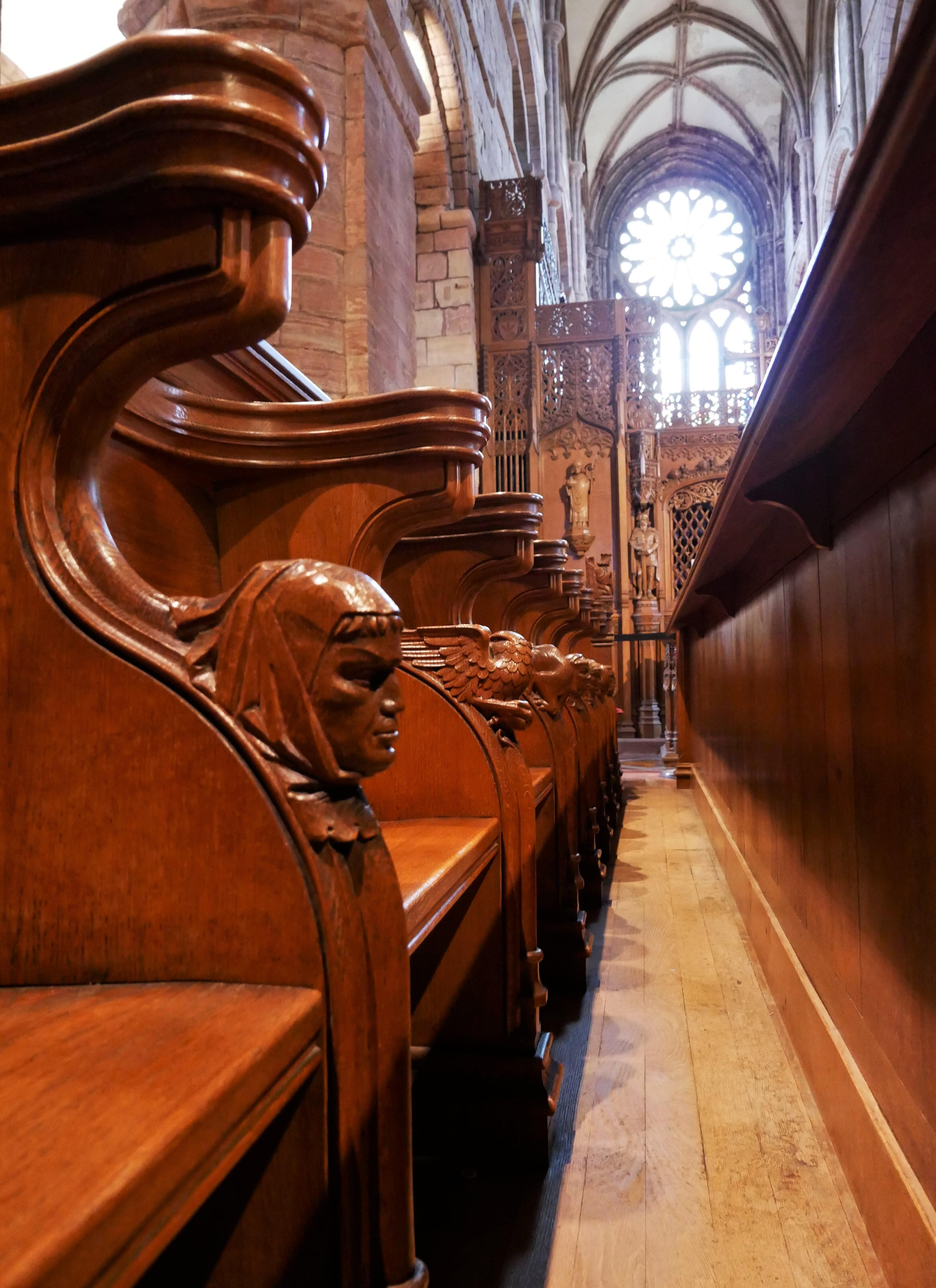 Wooden figures on the cathedral's pews - Kirkwall, Orkney Islands, Scotland, UK