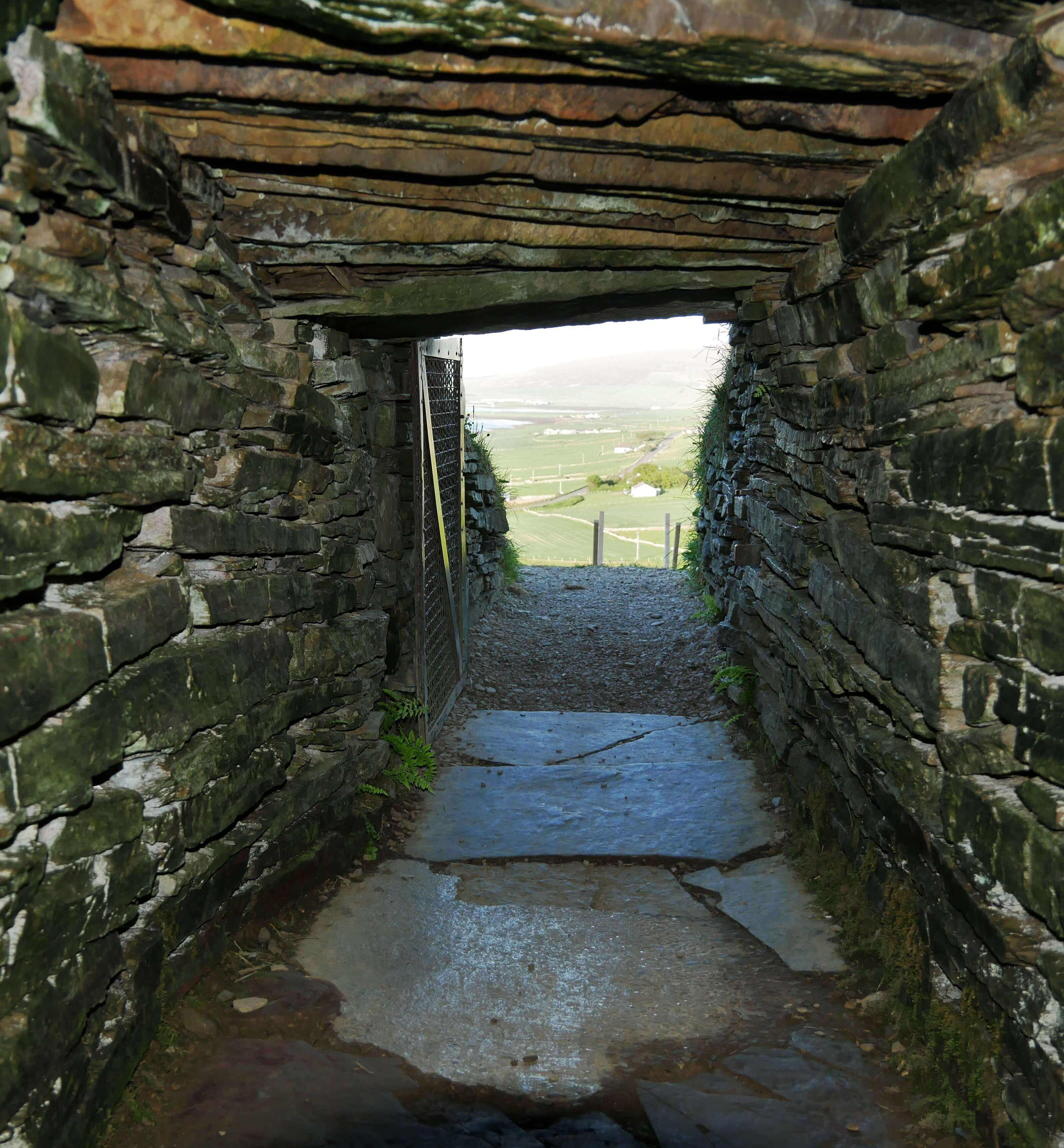 The view looking out of the passage of Cuween Chambered Cairn, Finstown, Orkney, Scotland