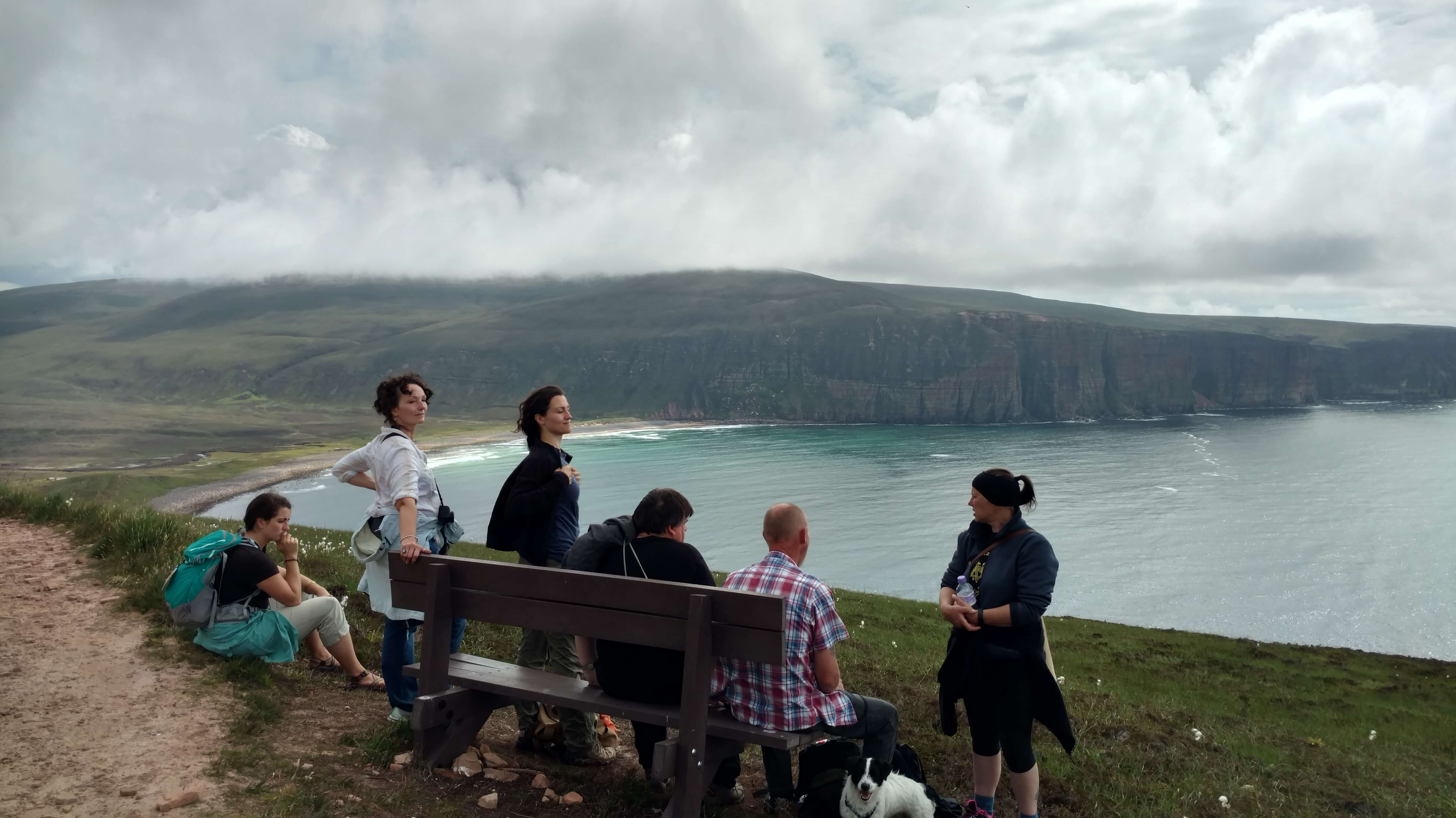 Hikers taking a break on a bench - the Old Man of Hoy walking trail.