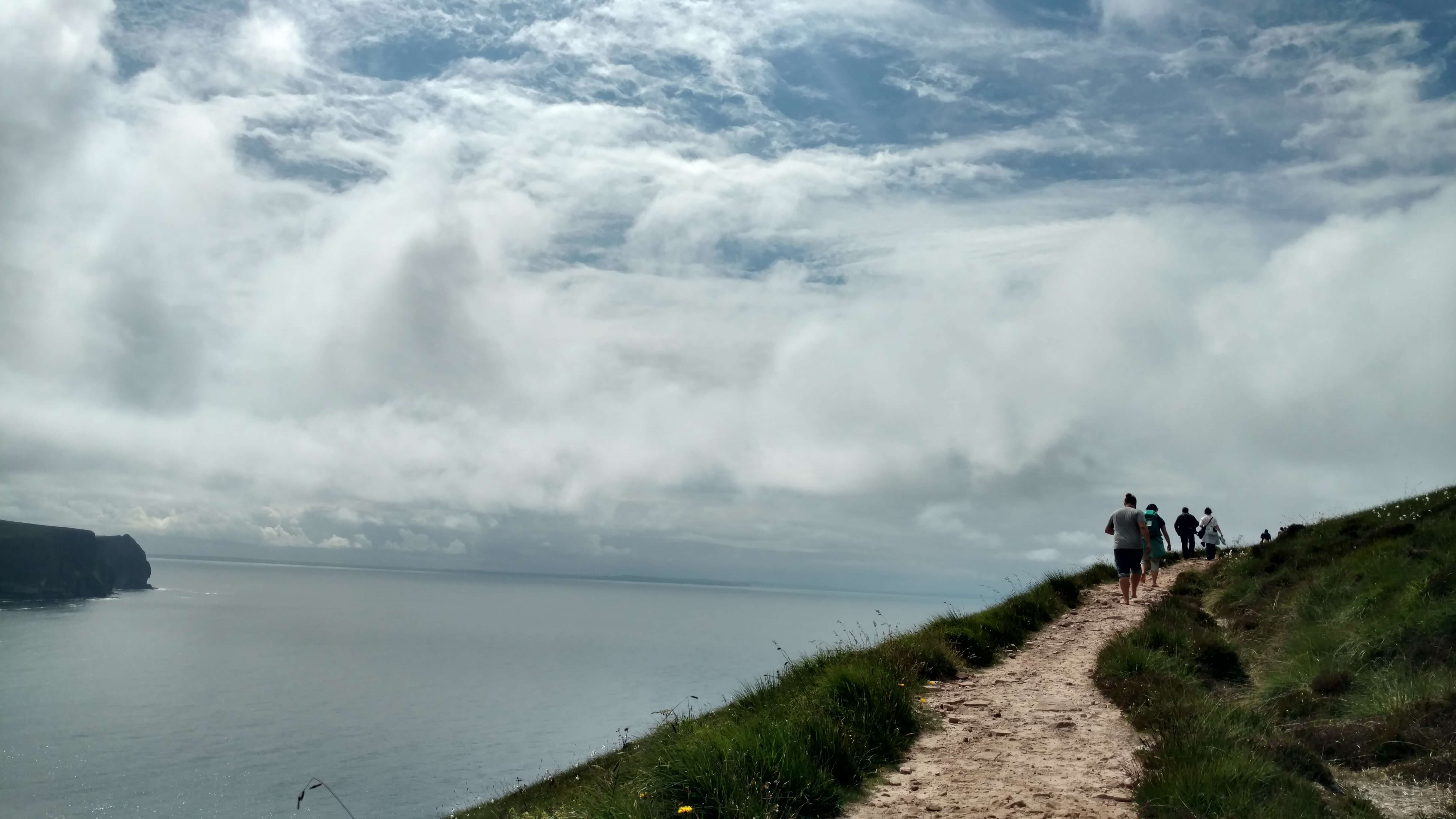 Visitors climbing the path leading to the Old Man of Hoy