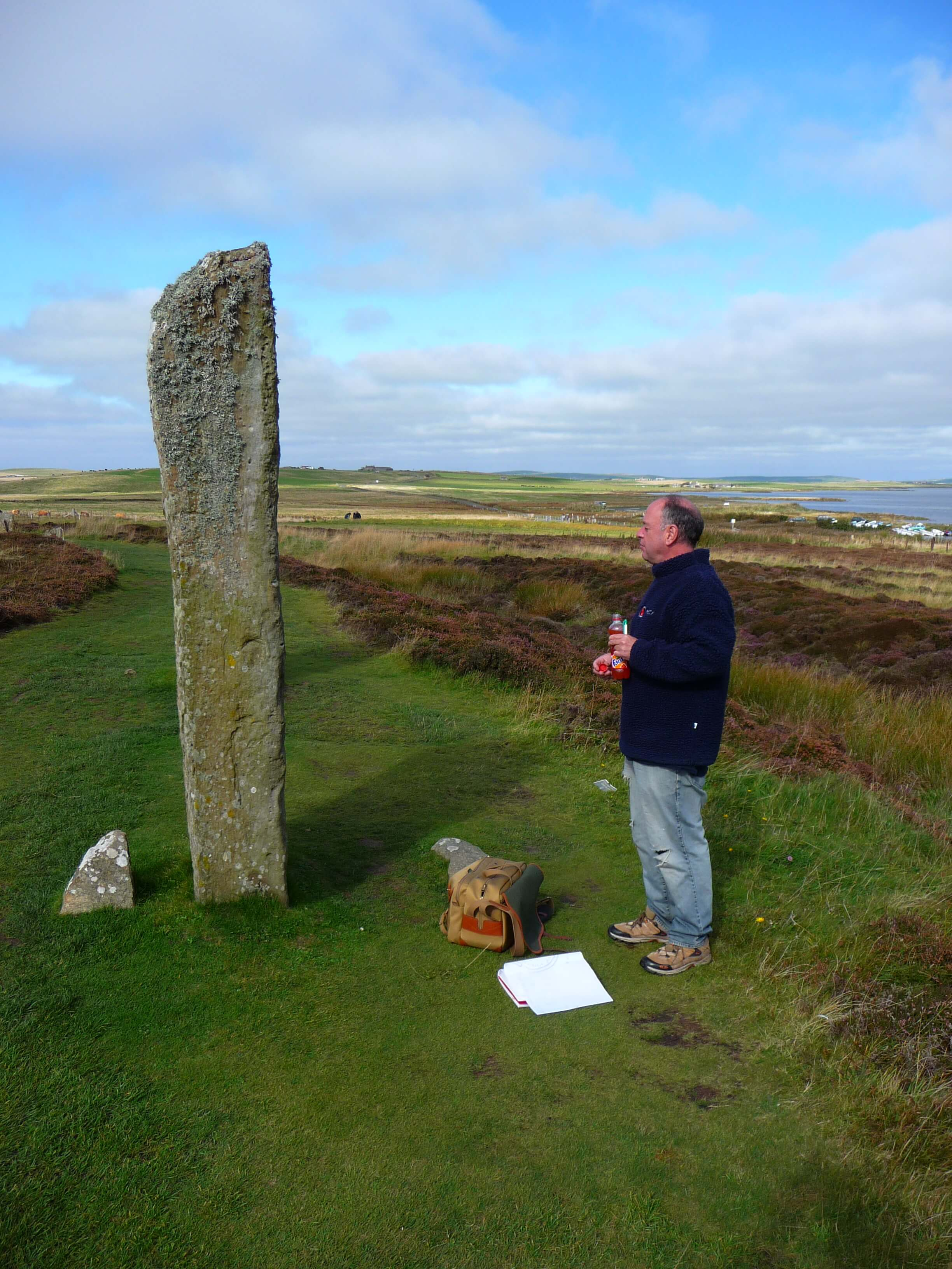 Prominent archaeologist Colin Richards at the Ring of Brodgar standing stones, Orkney Islands, Scotland, UK. Orkneyology.com