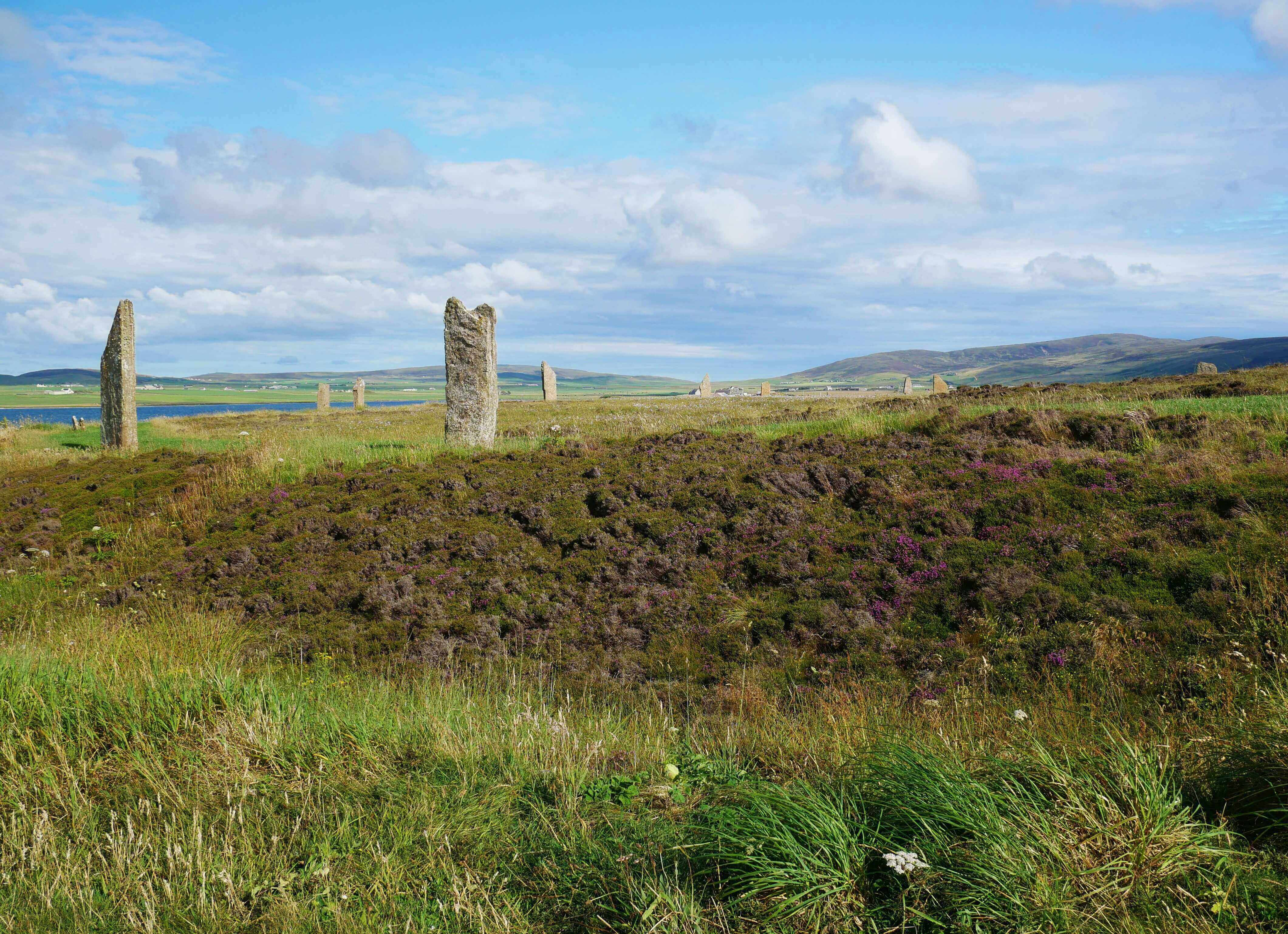 Hilly terrain surrounds the standing stone circle at Brodgar.  Orkney Islands, Scotland, UK. www.orkneyology.com