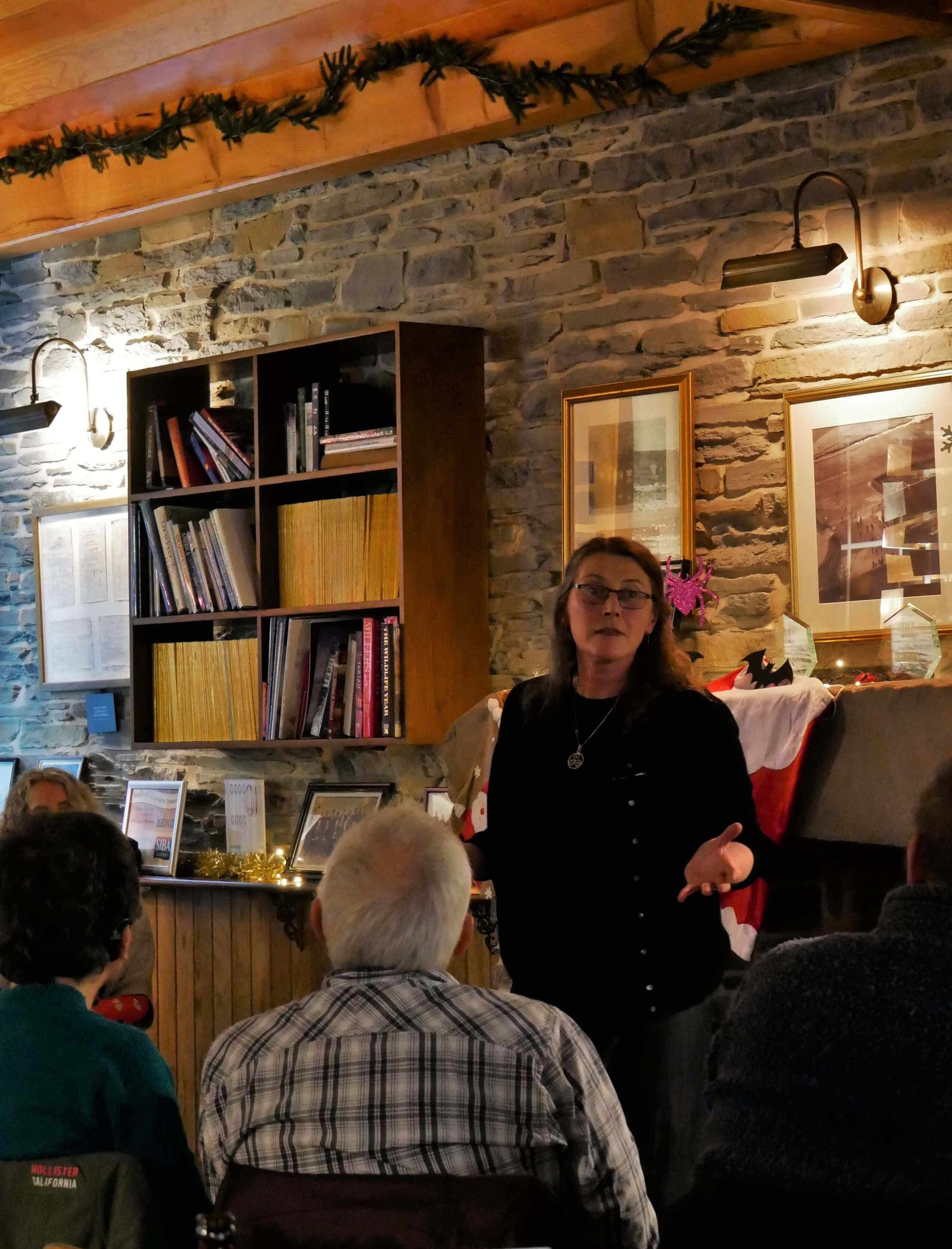 Storyteller and artist, Aine King of Highland Park House, Kirkwall, Orkney, telling a Christmas ghost story at The Orkney Brewery.