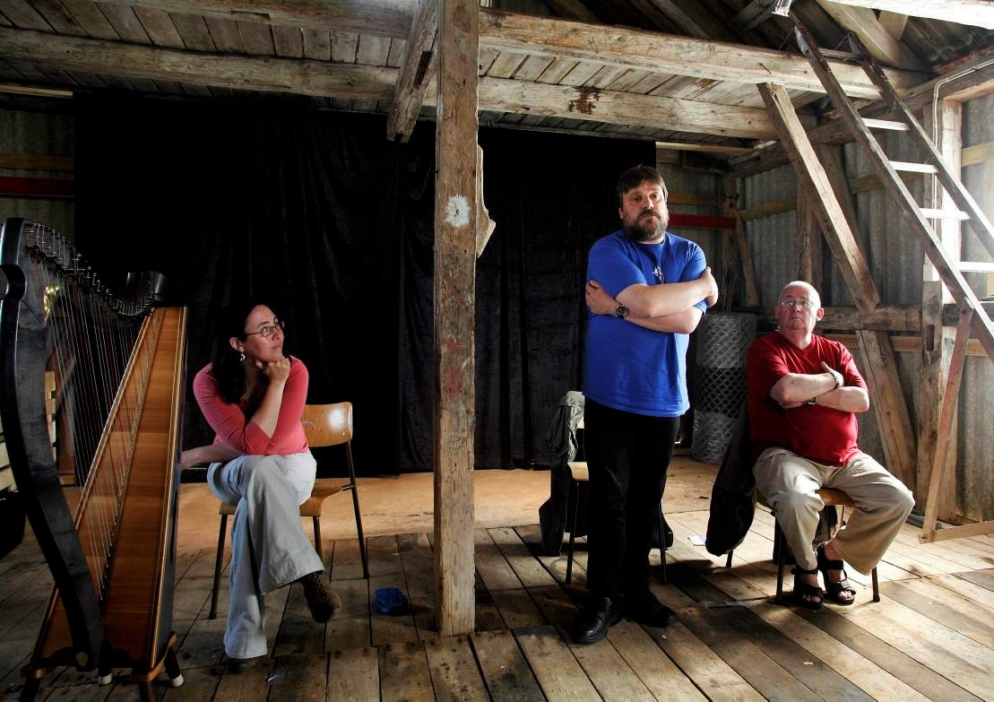 Scottish storytellers Heather Yule, Tom Muir of the Orkney Islands and Lawrence  Tulloch from Shetland telling traditional Scottish folk tales in Eigeroy, Norway.