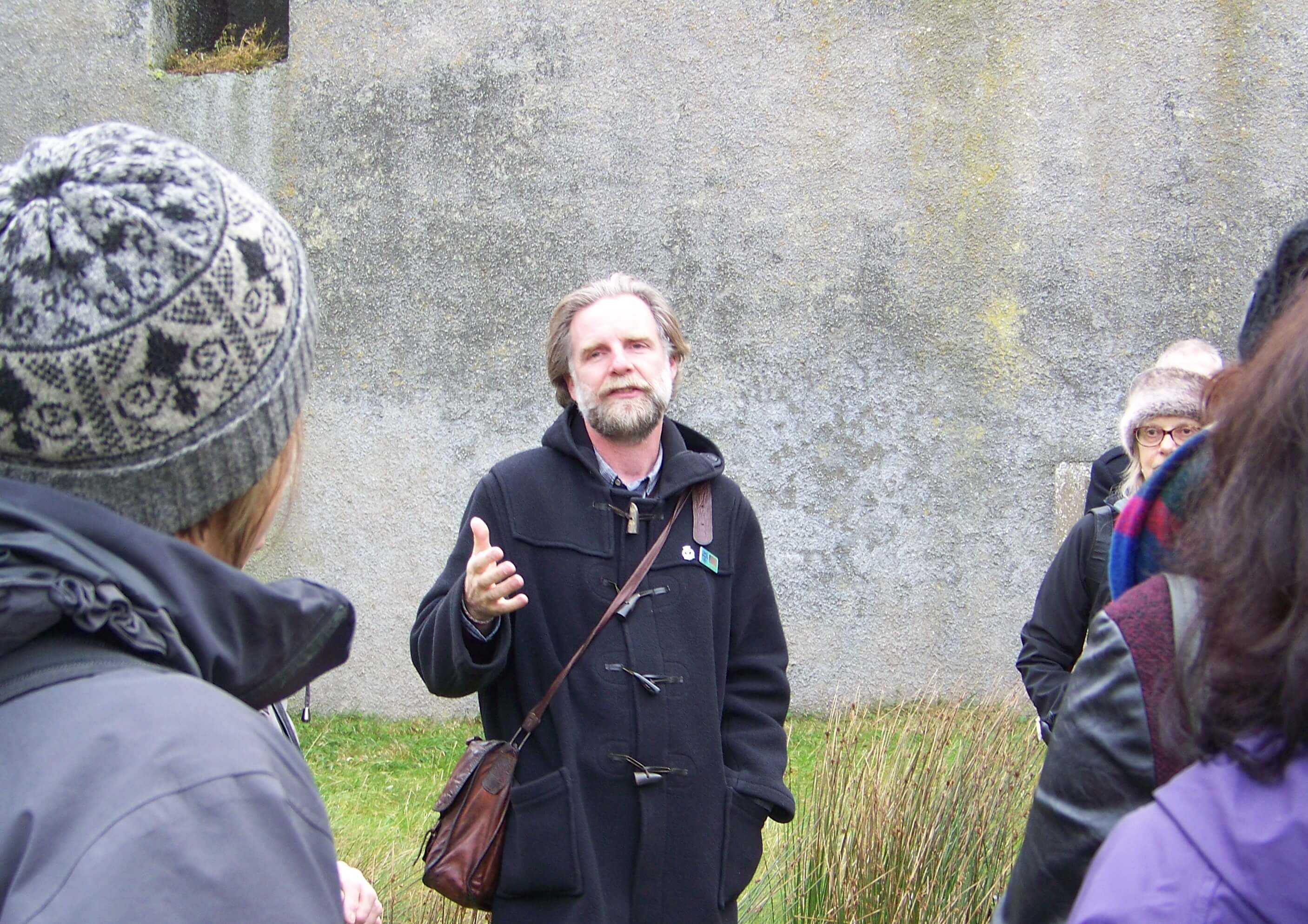 Andrew Hollinrake, Orkney tour guide giving a WW II battery tour on Flotta, Orkney Islands, Scotland, UK