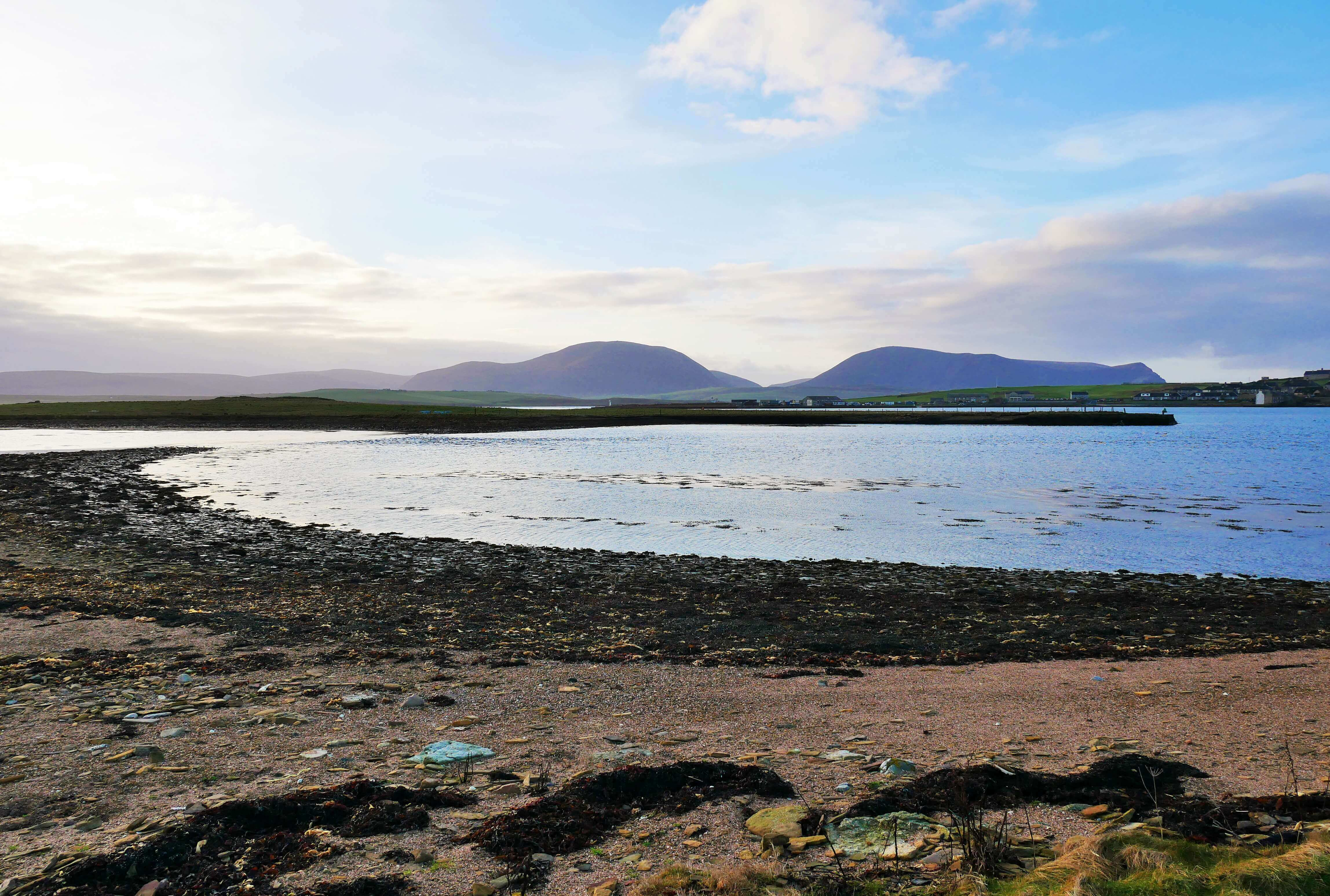 Causeway leading from Inner Holm to Outer Holm at low tide, Stromness, Orkney Islands, Scotland, UK.